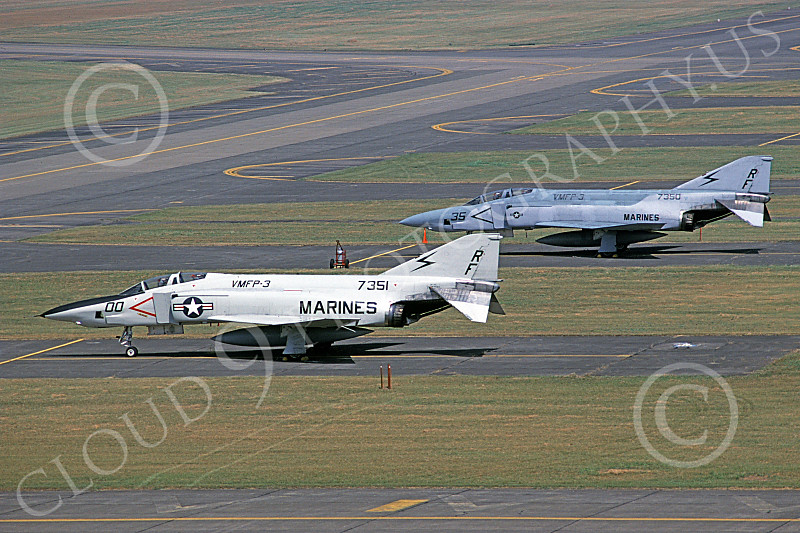 F-4USMC 00401 Two static different paint schemes McDonnell Douglas RF-4B Phantom IIs USMC 7351 7350 VMFP-3 EYES OF THE CORPS RF code Yokota AB 9-1984 military airplane picture by Toshiki Kudo