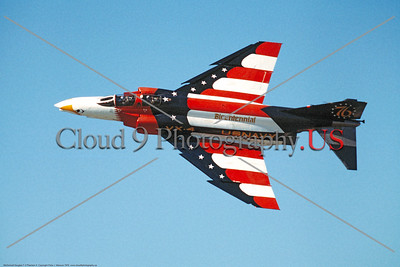 BIC-F-4USN 0002 A flying colorful McDonnell Douglas F-4 Phantom II USN jet fighter VX-4 THE EVALUATORS bicentennial markings 1976 military airplane picture by Peter J Mancus     DONEwt