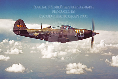 P-39 00002 An in-flight olive drab Bell P-39 Aircobra US Army Air Force WWII era fighter, military airplane picture, Official USAF Photograph