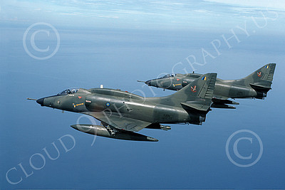 A-4Forg 00008 Two Brazilian Navy Douglas A-4 Skyhawk attack jets, military airplane picture, shown flying over a large body of water, by P Steinemann