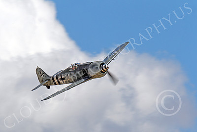 WB - Focke-Wulf Fw 190 00050 An in-flight Focke-Wulf Fw 190 German WWII era fighter in front of clouds, airplane picture, by Peter J Mancus