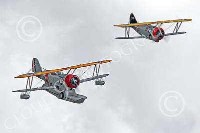 WB - Grumman J2F Duck 00042 A USMC Grumman J2F Duck float plane warbird in formation with a Grumman F3F biplane fighter warbird, by Peter J Mancus