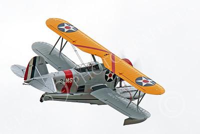 WB - Grumman J2F Duck 00018 A flying USMC Grumman J2F Duck float plane banks rights, by Peter J Mancus