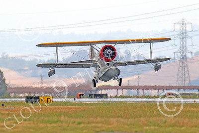 WB - Grumman J2F Duck 00012 A near head-on view of a USMC Grumman J2F Duck float plane warbird taking-off, by Peter J Mancus