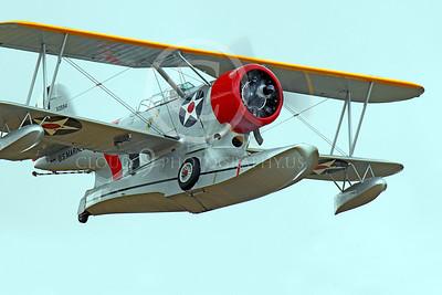 WB - Grumman J2F Duck 00054 A flying USMC Grumman J2F Duck float plane warbird by Peter J Mancus