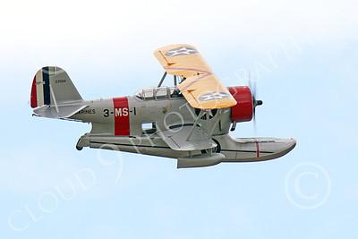 WB - Grumman J2F Duck 00038 A flying USMC Grumman J2F Duck float plane warbird airplane picture, by Peter J Mancus