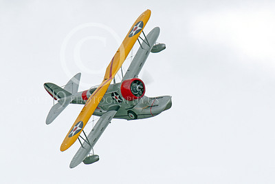 WB - Grumman J2F Duck 00050 A USMC Grumman J2F Duck float plane warbird in a steep turn right, by Peter J Mancus