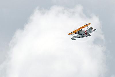 WB - Grumman J2F Duck 00008 A USMC Grumman J2F Duck float plane warbird high among the clouds, by Peter J Mancus