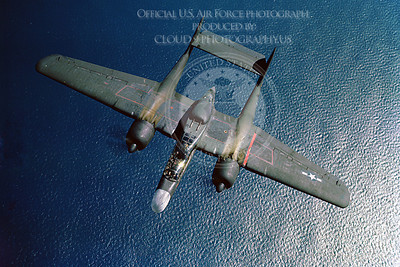P-61 00002 An olive drab Northrop P-61 Black Widow WWII era night fighter seen flying over the ocean, military airplane picture, Official USAF Photograph