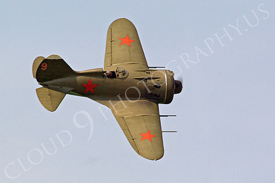 WB - Polikarpov I-16 00008 An in-flight World War II era Polikarpov I-16 warbird fighter plane in Soviet markings, by Stephen W D Wolf