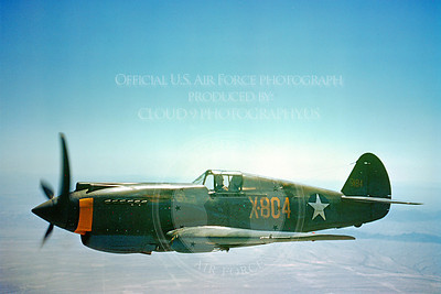 P-40 00008 An in-flight olive drab Curtiss P-40 Warhawk US Army Air Force WWII era fighter, military airplane picture, Official USAF Photograph