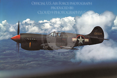 P-40 00004 An in-flight olive drab Curtiss P-40 Warhawk US Army Air Force WWII era fighter, military airplane picture, Official USAF Photograph