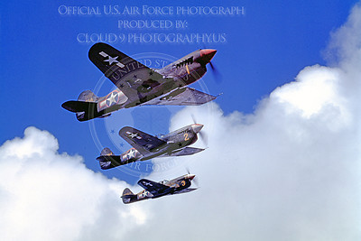 P-40 00006 Three in-flight olive drab Curtiss P-40 Warhawk US Army Air Force WWII era fighters, military airplane picture, Official USAF Photograph
