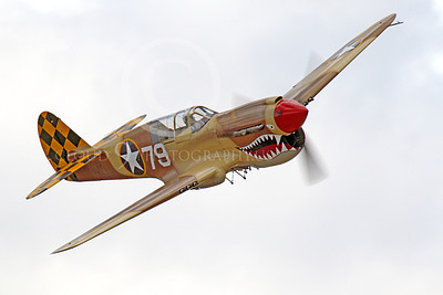 WB - Curtiss P-40 00078 A flying sharkmouth Curtiss P-40 Warhawk American WWII era fighter, by Peter J Mancus