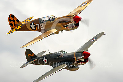 WB - Curtiss P-40 00029 Two sharkmouth Curtiss P-40 Warhawk American WWII era fighters fly in close formation, by Peter J Mancus
