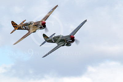 WB - Curtiss P-40 00074 Two sharkmouth Curtiss P-40 Warhawks fly in close formation, airplane picture, by Peter J Mancus