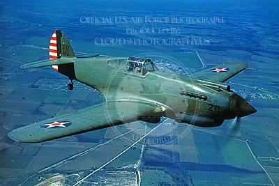 P-40 00002 An in-flight Curtiss P-40 Warhawk US Army Air Force WWII era fighter, military airplane picture, Official USAF Photograph