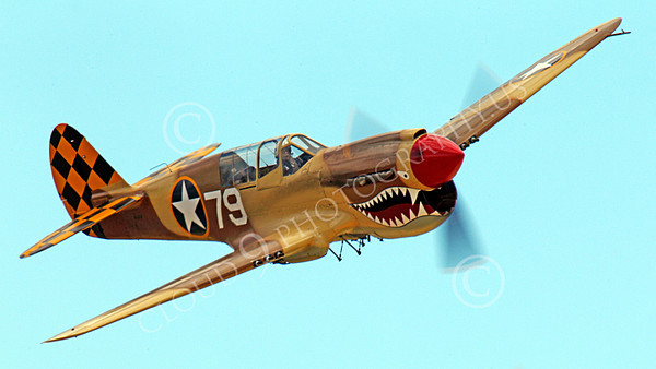 WB - Curtiss P-40 00054 A flying sharkmouth Curtiss P-40 Warhawk WWII era fighter warbird airplane picture by Peter J Mancus