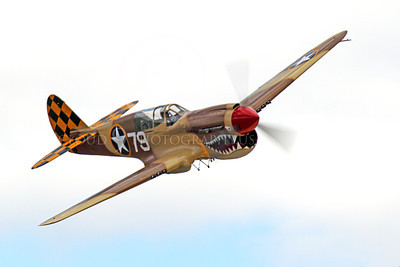 WB - Curtiss P-40 00094 A flying sharkmouth Curtiss P-40 Warhawk WWII era fighter warbird airplane picture by Peter J Mancus