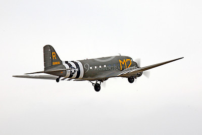 WB - Douglas C-47 Skytrain 00056 A Douglas C-47 Skytrain warbird retracts its under-carriage after taking-off, by Peter J Mancus
