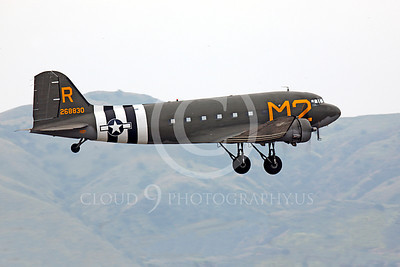 WB - Douglas C-47 Skytrain 00032 A Douglas C-47 Skytrain warbird takes off in front of foot hills, by Peter J Mancus