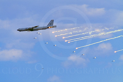 OR 00008 A USAF Boeing B-52 Stratofortress drops bombs while popping flares designed to fool heat seeking air-to-air anti-aircraft missiles, by Peter J Mancus