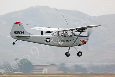 WB - Cessna O-1 Bird Dog 00046 A sharkmouth USAF Cessna O-1 Bird Dog warbird makes a low pass, by Peter J Mancus