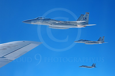 F-15USAF 00236 Three USAF McDonnell Douglas F-15 Eagle jet fighter off the right wing tip of a USAF Boeing KC-135 Stratotanker, by Peter J Mancus