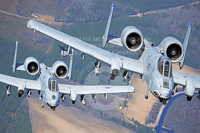 Two A-10C Thunderbolt II aircraft pilots fly in formation during a training exercise March 16, 2020, at Moody Air Force, Ga. Members of the 74th Fighter Squadron performed surge operations to push its support function to the limit and simulate pilots' wartime flying rates. (U.S. Air Force photo/Airman 1st Class Benjamin Wiseman)