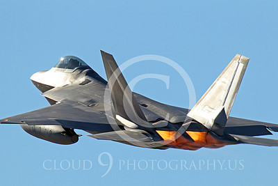 AB - F-22 00164 A USAF Lockheed Martin F-22 Raptor stealth fighter, OT 06120, with under-wing fuel tanks takes off in afterburner at Nellis AFB, by Peter J Mancus