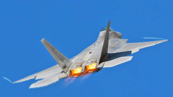 AB-F-22 00176 A USAF Lockheed Martin F-22 Raptor air superiority steatlh jet fighter in afterburner with wing tip contrails military airplane picture by Peter J Mancus