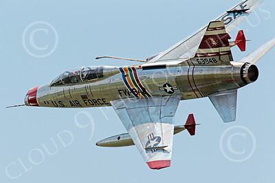 WB - F-100 00014 A flying North American F-100F Super Sabre USAF jet fighter, FW-948 63948, warbird banks left to turn, by Peter J Mancus