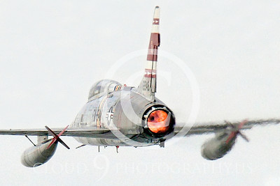 WB - F-100 00031 A North American F-100F Super Sabre USAF jet fighter, FW-948 63948, warbird in afterburner, by Peter J Mancus