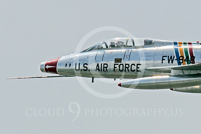 WB - F-100 00026 Close up of a flying North American F-100F Super Sabre USAF jet fighter, FW-948 63948, warbird's nose, by Peter J Mancus