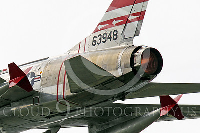 WB - F-100 00046 Close up of the afterburner of a flying North American F-100F Super Sabre USAF jet fighter, FW-948 63948, warbird, by Peter J Mancus