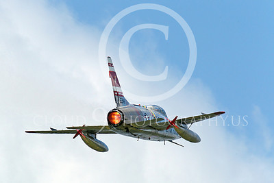 WB - F-100 00020 A flying North American F-100F Super Sabre USAF jet fighter, FW-948 63948, warbird in full afterburner, by Peter J Mancus
