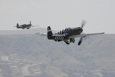 WB - North American P-51 Mustang 00092 North American P-51 Mustang US Army Air Corps World War II fighter warbird with Curtiss P-40 Warhawk fighter warbird by Peter J Mancus
