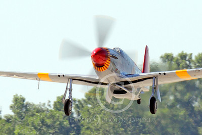 WB - North American P-51 Mustang 00067  A Tuskegee Airmen North American P-51 Mustang warbird takes off at the Oshkosh 2011 airshow, by Peter J Mancus