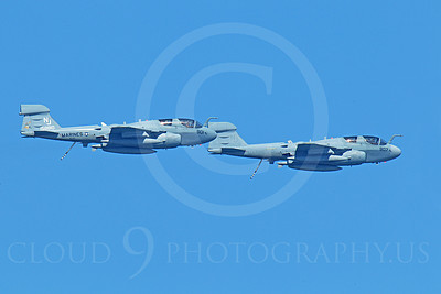 EA-6BUSMC 00014 Two USMC Grumman EA-6B Prowlers assigned to VAQ-129 VIKINGS, 158810 an 159908, fly in close formation, by Peter J Mancus