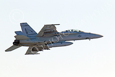 Boeing F-18F - USN 00084 Quarter rear right side view of an in-flight US Navy Boeing F-18F Super Hornet AB tail code military airplane picture, by Peter J Mancus