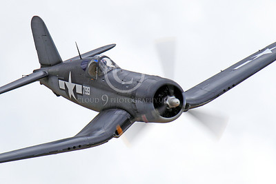 WB - Chance Vought F4U Corsair 00023 A USN Chance Vought F4U Corsair warbird WWII era fighter in flight airplane picture by Peter J Mancus