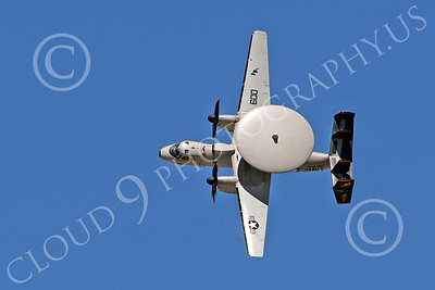 E-2USN 00014 The pilot of a USN Grumman E-2 Hawkeye stands it on its left wing tip, by Peter J Mancus
