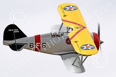 WB - Grumman F3F 00044 Top side view of a flying Grumman F3F biplane fighter warbird turning right, airplane picture, by Peter J Mancus