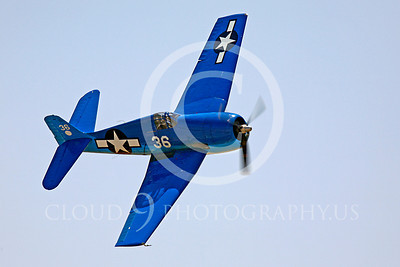 GRUMMAN F6F HELLCAT IN BRIGHT BLUE COLOR SCHEME IN FLIGHT IN A STEEP BANK.