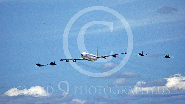 FORM 00022 A Canadian Armed Forces Boeing C-135 flies in formation with four Canadian Northrop F-5 Freedom Fighters military airplane picture by Michael Grove, Sr