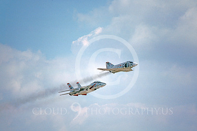 FORM 00006 A USN F-4 Phantom II VF-121 PACEMAKERKS and a USN F-14 Tomcat VF-114 AARDVARKS fly in formation military airplane picture by Michael Grove, Sr