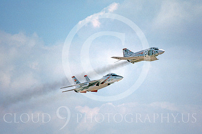 FORM 00018 A USN F-4 Phantom II VF-121 PACEMAKERKS and a USN F-14 Tomcat VF-114 AARDVARKS fly in formation military airplane picture by Michael Grove, Sr
