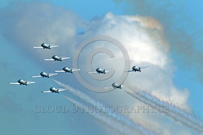CAFSB 00008 A nine plane Canadian Armed Forces' Snowbirds formation climbs with clouds in the background military airplane picture by Peter J Mancus