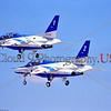 JBI-T-4 0002 Flying JASDF (Japanese Air Self-Defense Force) Kawasaki T-4 Blue Impulse aerobatic team jet trainers at Nellis AFB 1997, military aerobatic team picture by Peter J  Mancus     DONEwt