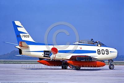 JBI-F-86 0001 A static colorful North American F-86F Sabre jet fighter Japanese Self Defense Force BLUE IMPULSE aerobatic flight demonstration team 82-7809 Hyaituri Air Base 4-1973 military airplane picture by Hideki Nagakubo